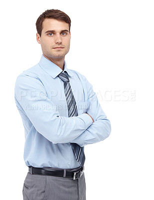 Buy stock photo Handsome young businessman standing with his arms folded - copyspace