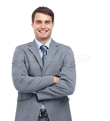 Buy stock photo Handsome young businessman standing with his arms folded - portrait