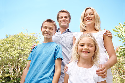 Buy stock photo Portrait of a happy family standing outside
