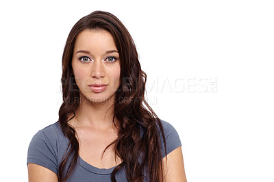 Buy stock photo Casually dressed young woman standing against a white background