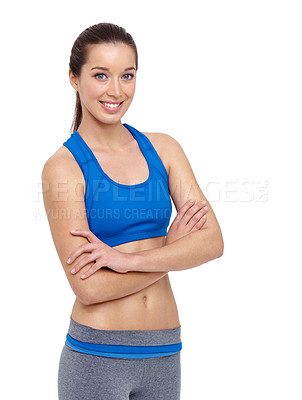 Buy stock photo A fit young woman crossing her arms while isolated on a white background