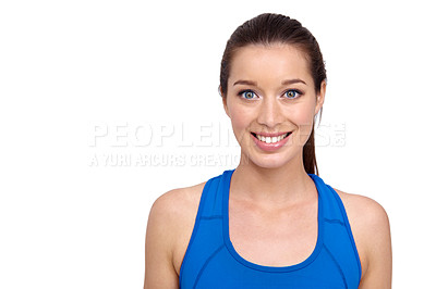 Buy stock photo A pretty young woman in sportswear smiling at you alongside copyspace