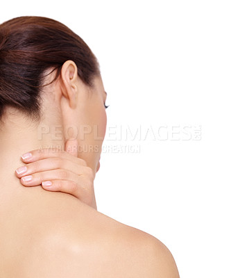Buy stock photo A young woman rubbing her neck while isolated on white background