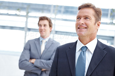 Buy stock photo An ambitious businessman smiling and looking away thoughtfully