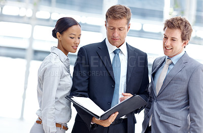 Buy stock photo An experienced business team going over their notes before an important meeting