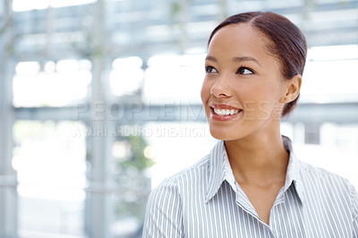 Buy stock photo A pretty african american woman looking thoughtfully towards copyspace