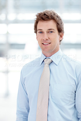 Buy stock photo Portrait of a young ambitious businessman standing in the office