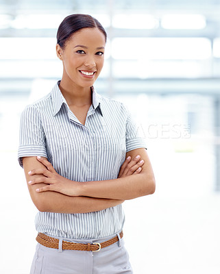 Buy stock photo A pretty african american businesswoman crossing her arms and smiling alongside copyspace