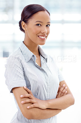 Buy stock photo A pretty african-american businesswoman crossing her arms and smiling at you