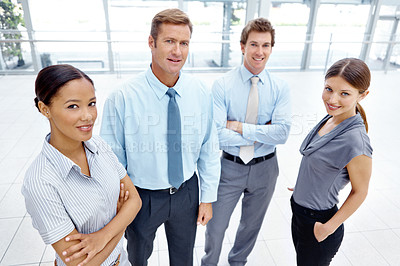 Buy stock photo A team of businesspeople standing together in the office lobby