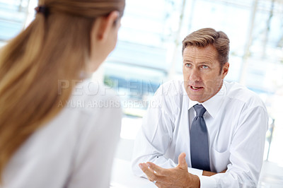 Buy stock photo Young woman being interviewed by a mature businessman