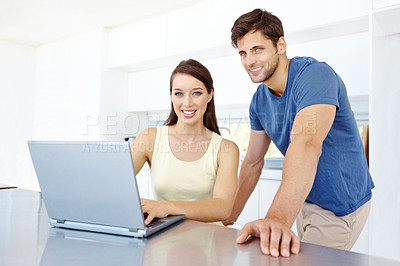 Buy stock photo A portrait of a happy couple looking at their laptop