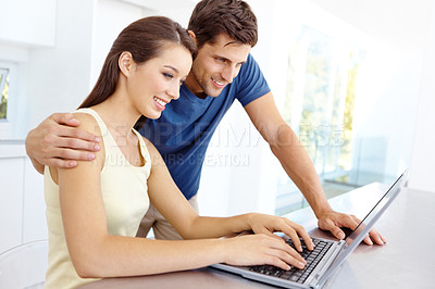 Buy stock photo Boyfriend showing his girlfriend how to work the laptop