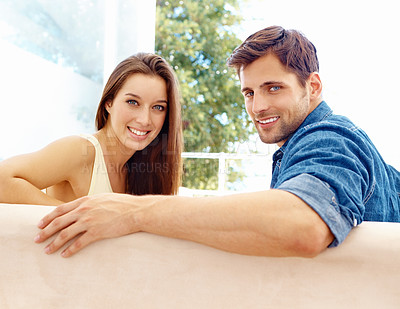 Buy stock photo Portrait of a smiling couple on their couch