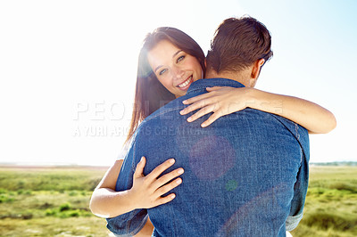 Buy stock photo A loving girlfriend embracing her handsome boyfriend
