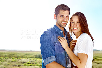 Buy stock photo Portrait of a good looking couple standing in the outdoors with copyspace