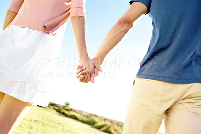 Buy stock photo Close up of a couple holding hands