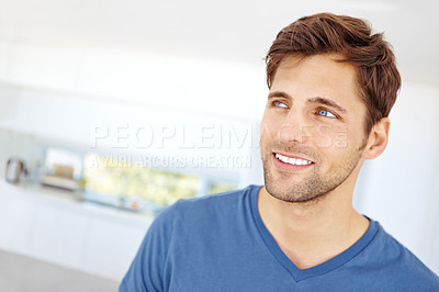 Buy stock photo Shot of a handsome young man relaxing at home