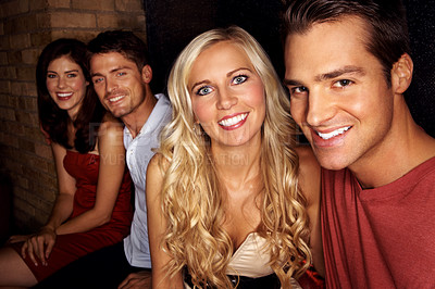 Buy stock photo Two couples sitting in a nightclub
