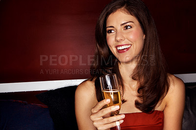 Buy stock photo Portrait of a beautiful woman holding a glass of champagne in a night club