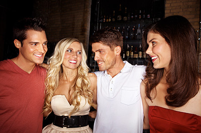 Buy stock photo Group of friends chatting in a night club