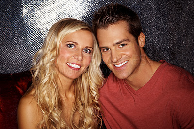 Buy stock photo Closeup portrait of a good-looking young couple sitting in a nightclub