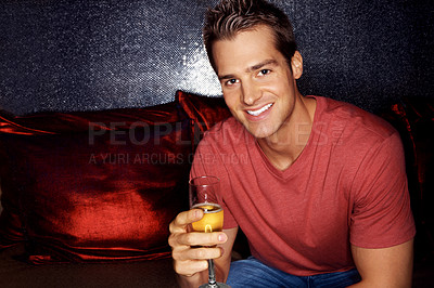 Buy stock photo Closeup portrait of an handsome young man drinking champagne with his friends sitting behind her