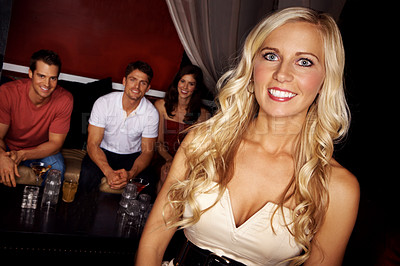 Buy stock photo Portrait of an attractive blonde woman with her friends at a nightclub