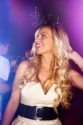 Buy stock photo Shot of an attractive blonde woman dancing in a nightclub