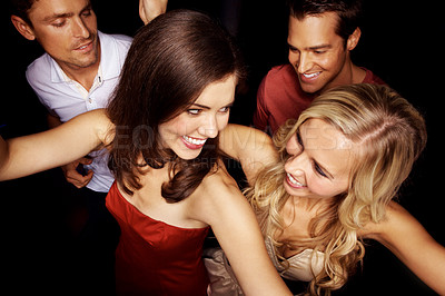 Buy stock photo High angle shot of a group of young people dancing in a club