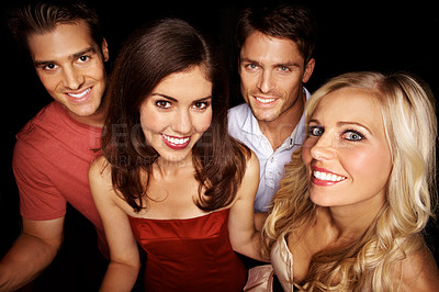 Buy stock photo High angle portrait of a group of young people standing in a nightclub