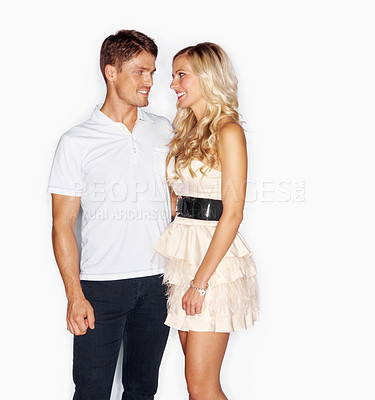 Buy stock photo Studio portrait of a good-looking young couple isolated on white