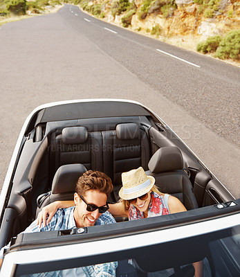 Buy stock photo High-angle view of a young couple driving their car while on a roadtrip