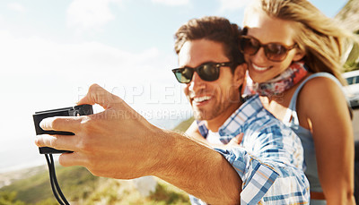 Buy stock photo A young couple taking a self-portrait outside