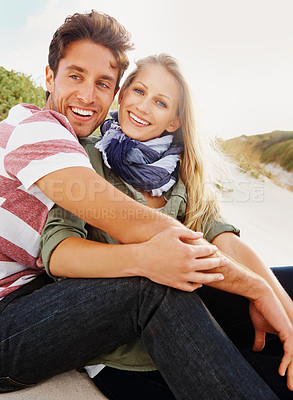 Buy stock photo A happy young couple sitting on their car while on a roadtrip
