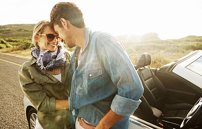 Buy stock photo An affectionate young couple looking into one anothers' eyes while on a roadtrip