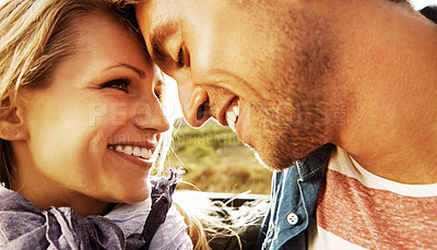 Buy stock photo Closeup of a young couple looking lovingly into one anothers' eyes while on a roadtrip