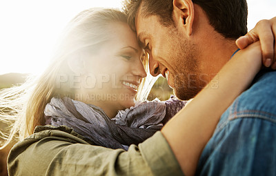 Buy stock photo An affectionate young couple looking into one anothers' eyes