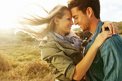 Buy stock photo A loving young couple looking into one anothers' eyes