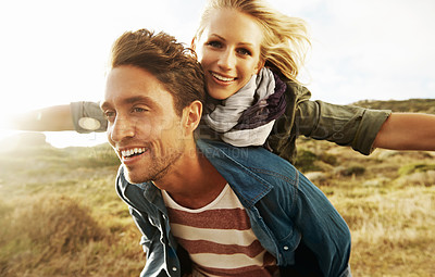 Buy stock photo A playful young couple enjoying the outdoors