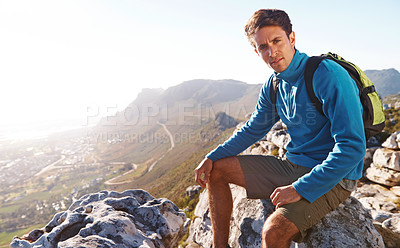 Buy stock photo Handsome hiker sitting at the top of a mountain