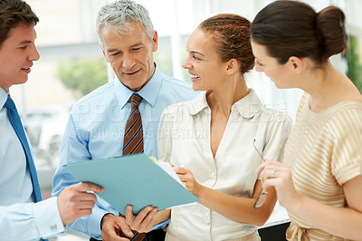 Buy stock photo Group of experienced business colleagues disscussing on new business strategy
