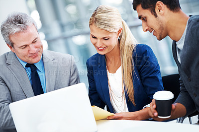 Buy stock photo A group of businesspeople discussing documents during a meeting