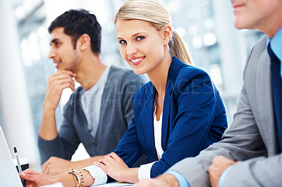 Buy stock photo A gorgeous young businesswoman sitting in between her colleagues
