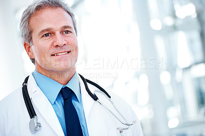 Buy stock photo A handsome doctor with a stethoscope around his neck