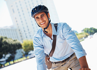 Buy stock photo A young businessman riding to work on a bicycle