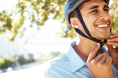 Buy stock photo A young businessman fastening his helmet underneath his chin