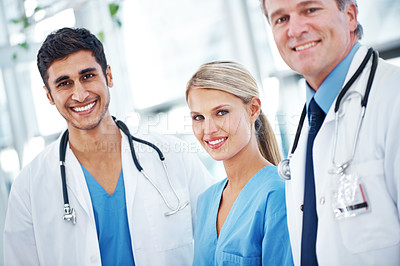 Buy stock photo A group of doctors smiling together at the camera