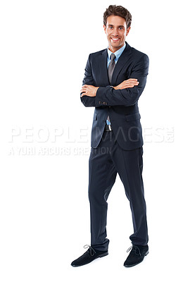 Buy stock photo A handsome young businessman standing with his arms folded against a white background