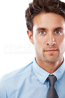 Buy stock photo A handsome young businessman looking at the camera